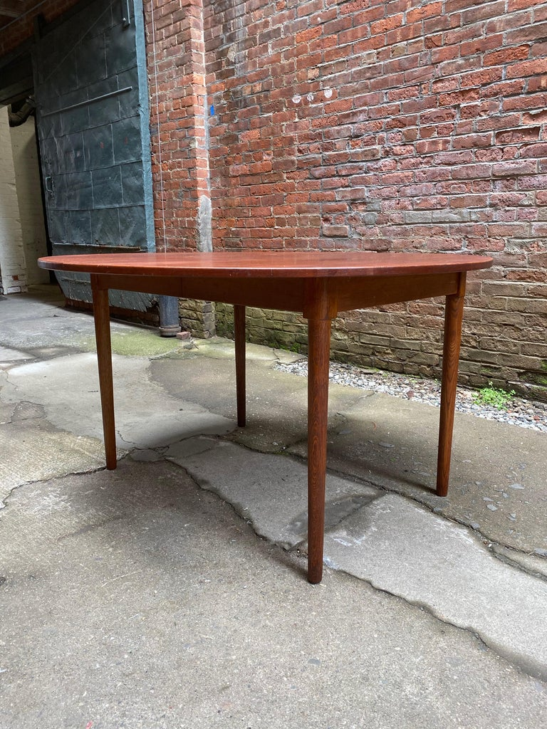 Scandinavian Modern Teak and Oak Dining Table In Good Condition For Sale In Garnerville, NY