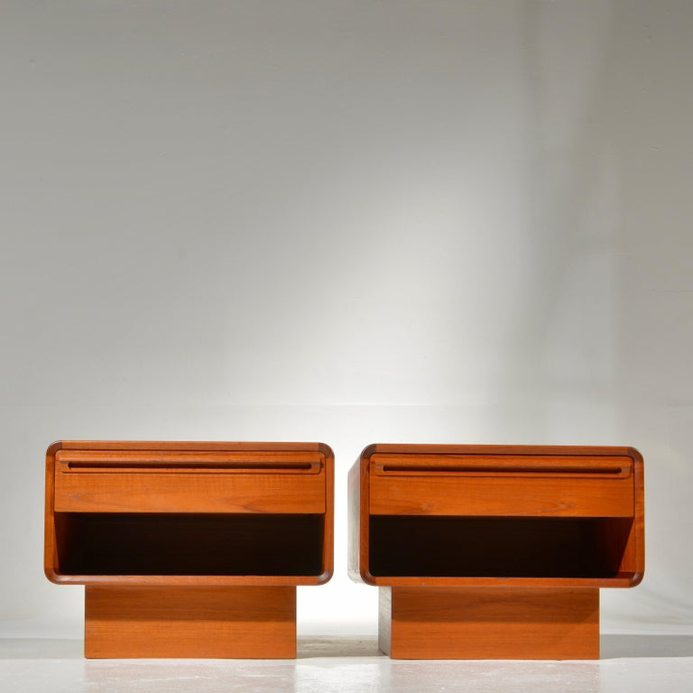 These are unique Danish modern nightstands with rounded corners and storage drawer.