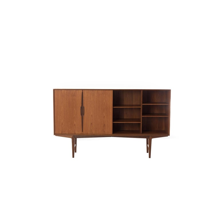 This piece pretty much speaks for itself. Sliding doors with sculptural pulls, pullout / pull-out silver trays, adjustable shelves. Base is detachable for transport. lovely old growth teak with oil finish.  Professional, skilled furniture