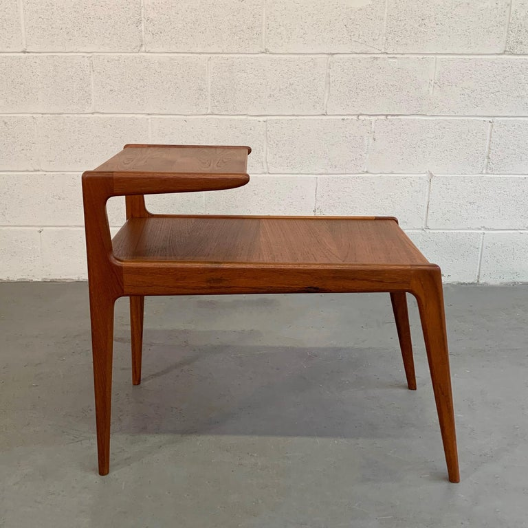 Scandinavian Modern, teak side table with recessed, stepped top tier at 24.5 inches height and bottom table at 18 inches height. The table features beautifully tapered lines and wonderful joinery.