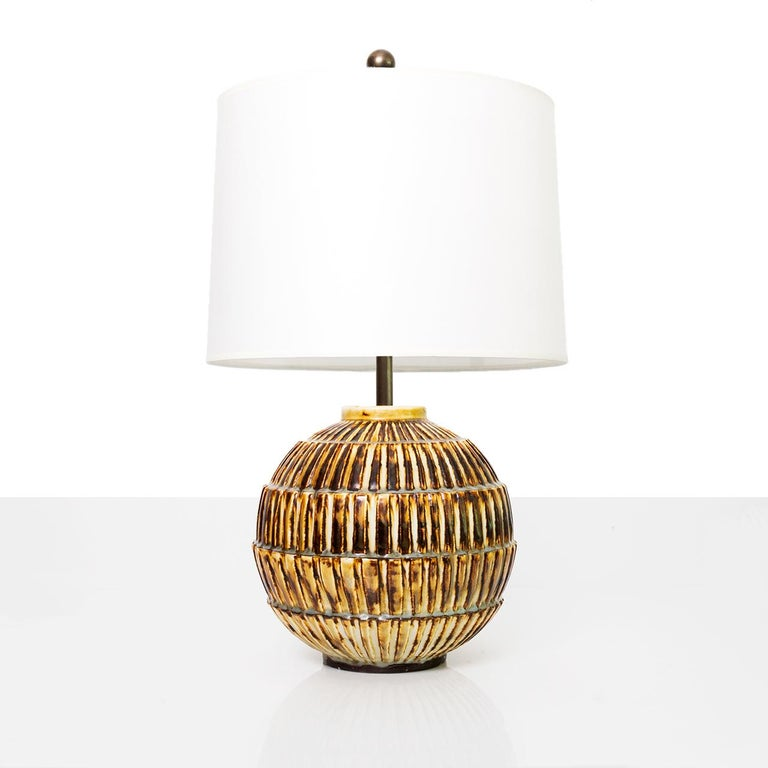 Large and rare Swedish art deco unique ceramic studio lamp by Gertrud Lonegren. Her pieces are known for strongly textured surfaces combined with subtle use of glazes. Lamp has been rewired with a polished and lacquered brass double cluster and two