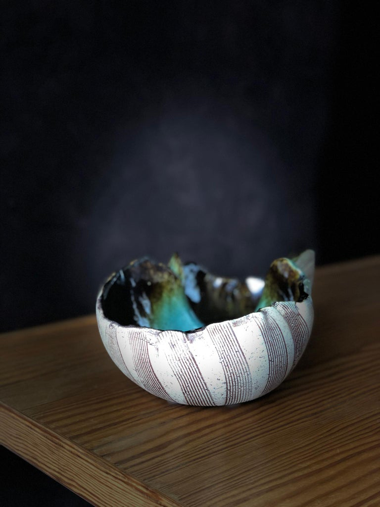Scandinavian Modern very unusual hand built double bowl by artist Bengt Berglund. The asymmetric form are typical for Bengt Berglunds design produced at Gustafsbergs Studio between 1960-1977. The exterior of the bowl is partially glazed. The