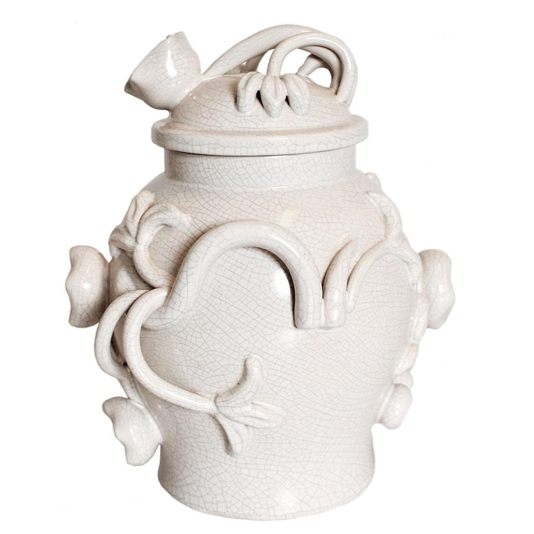 Scandinavian Modern urn with lid earthenware by Eva Jancke Björk (Birch) 1882-1981), Bobergs Faiance pottery, model 3428 in white glased cracked pattern, ceramic/faience gods. Relief decoration with flowers and leafs designed for the Bobergs Fajans
