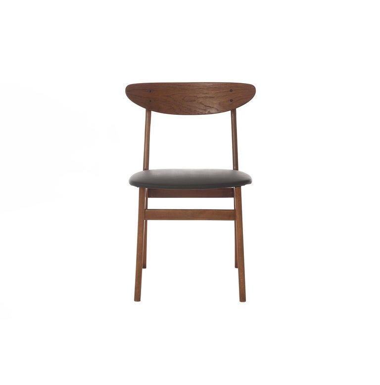 This set of 8 Classic vintage danish modern dining chairs have teak back splats and stained beechwood frames. Joints are solid and seats have been re-upholstered in a Classic black pleather in the spirit of the original.   Professional, skilled