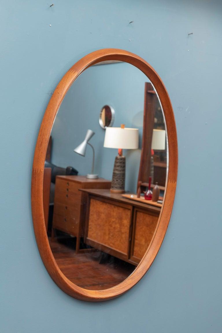 Scandinavian modern teak oval wall mirror by Pedersen & Hansen, Denmark. Large mirror 44