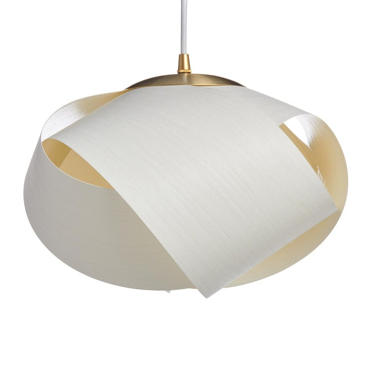 This Mid-Century Modern lighting is an organic modern designer style. This contemporary pendant in wood veneer gives a warm light. There are many luxury design applications for this mini pendant, in pairs over a kitchen island, in entryways or