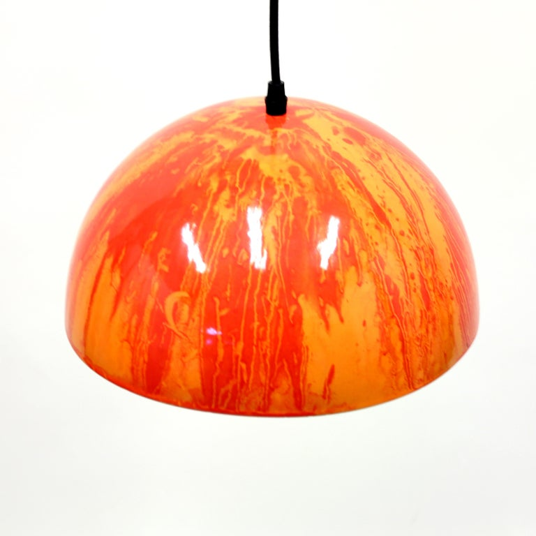 Red and orange enamel ceiling lamp from the 1970s. Most likely Swedish or Danish. White on the inside. Unknown producer. Good vintage condition with minor ware and completely new electric components including cable and plug.