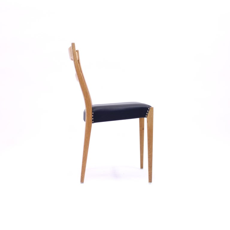 Scandinavian Oak Dining Chairs with Black Leather Seats, 1950s For Sale 9