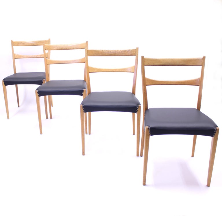 Swedish Scandinavian Oak Dining Chairs with Black Leather Seats, 1950s For Sale