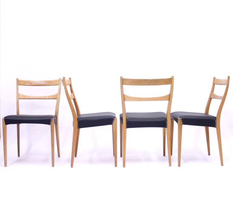 20th Century Scandinavian Oak Dining Chairs with Black Leather Seats, 1950s For Sale
