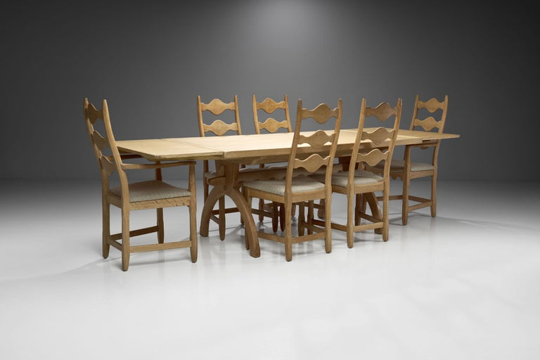 This impressive Scandinavian dining set of seven has an undeniable commanding presence; it begs to be left alone so that air and light can circulate through it. Marked by pale colors, natural materials and lean furniture, the Scandinavian aesthetic