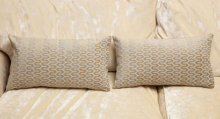 One of the kind silver pair of decorative pillows, designed by Arlene Angard Designs. Zigzag pattern adds texture and easily adaptable to any interior space with its neutral color.  Closure stitch with a custom made pillow insert of down