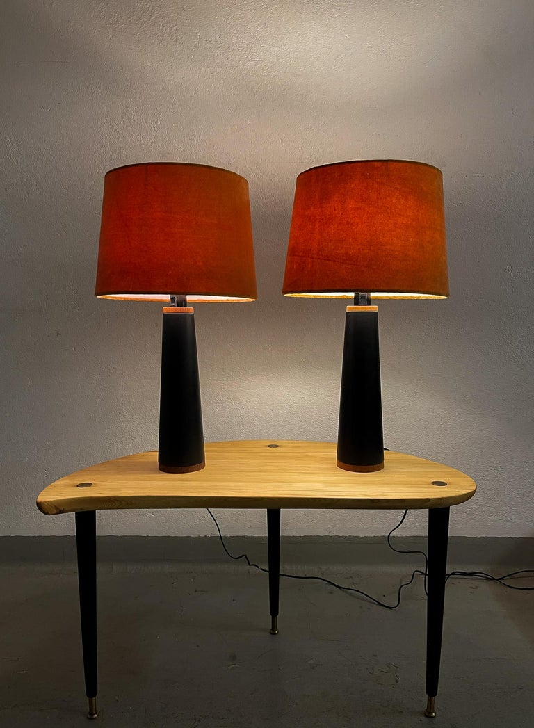 Pair of table lamps manufactured in Sweden and Luxus. They are made in black synthetic leather with stiches around a teak base.  The shades are the original ones can be included if buyer wants.   Nice vintage condition. Rewired  Dimensions: