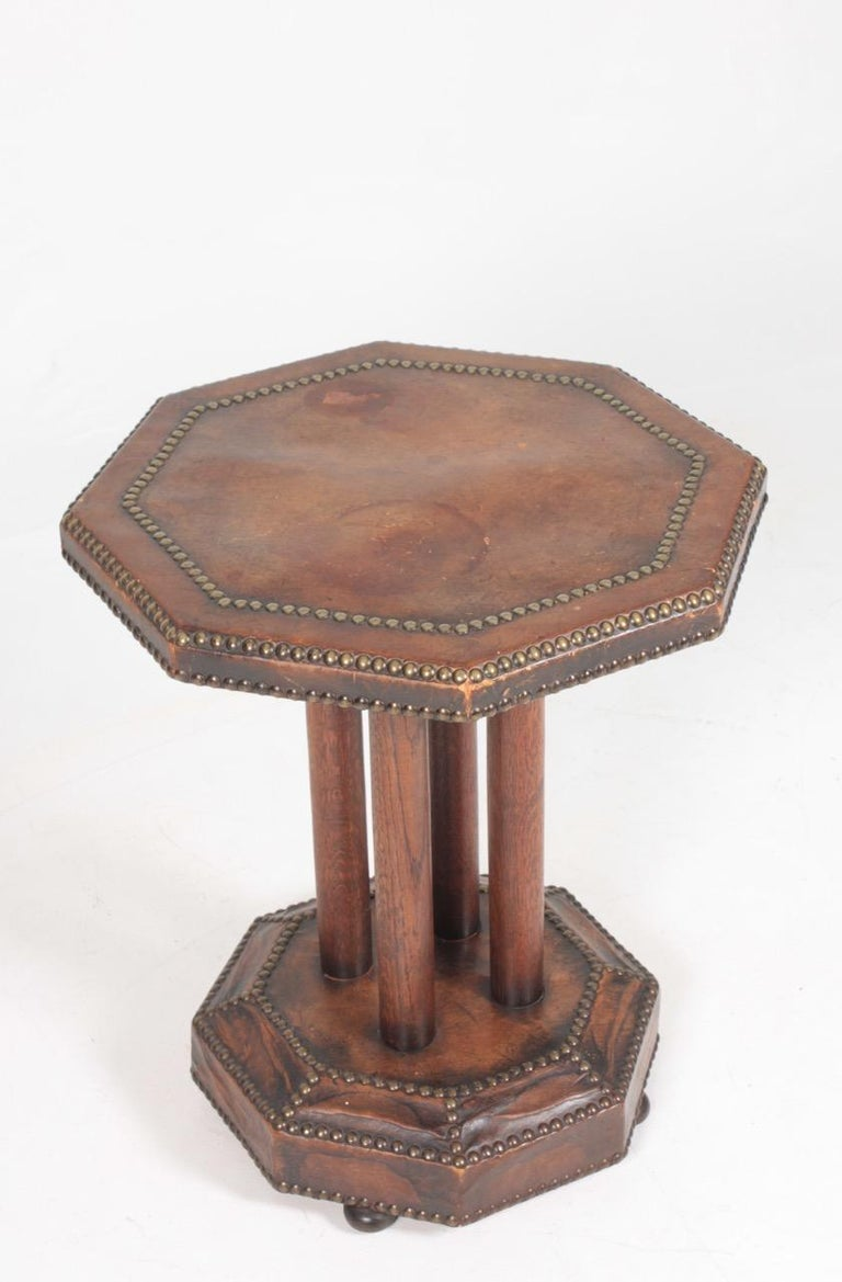 Side table with patinated leather top and brass nails. Designed by Otto Schulz and made by Boet Sweden. Great original condition.
