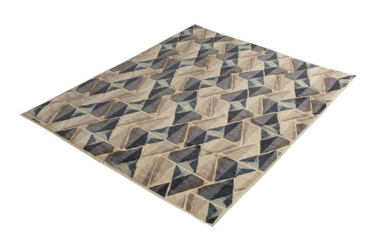 Hand knotted in texturally soft, durable wool pile, this modern 8 x 10 rug hails from the latest pile additions to Rug & Kilim's Scandinavian collection, a celebration of Swedish modernism with new large scale geometry and exciting vintage colorways