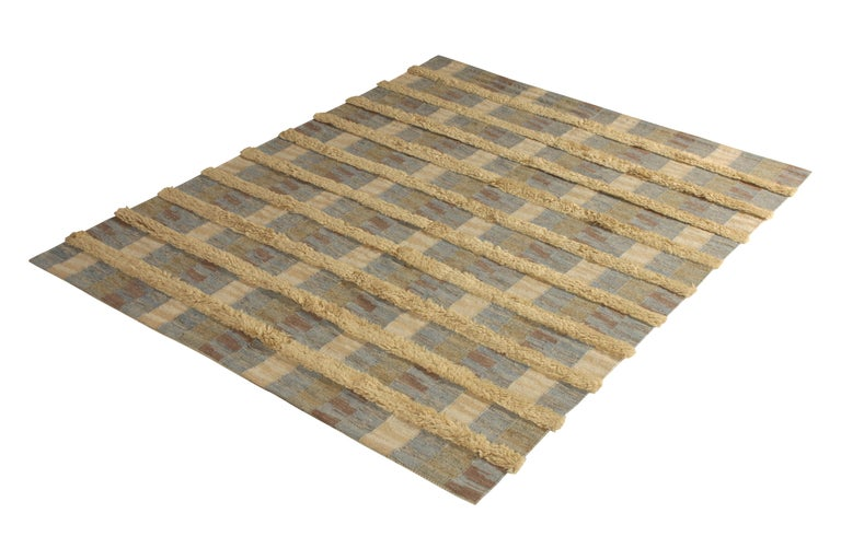 Hand knotted in texturally soft, durable wool pile, this modern 8 × 10 rug hails from the latest pile additions to Rug & Kilim's Scandinavian collection, a celebration of Swedish modernism with new large scale geometry and exciting vintage colorways