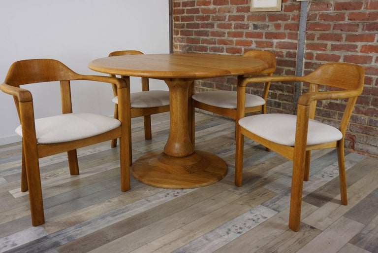 Solid oak dining set Scandinavian style composed of a round solid oak dining table (H 75cm / diam 115cm) with tulip shape foot (diam 70cm) and four matching dining armchairs (H77cm / H seat 47cm / W61cm / D55cm) in solid oak and fabric... All In