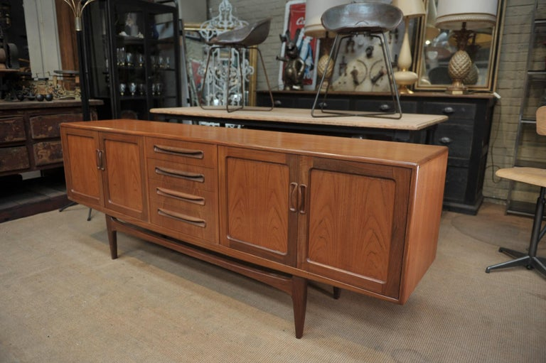 Teak Credenza 4-doors 4 drawers all in very good condition, circa 1960.