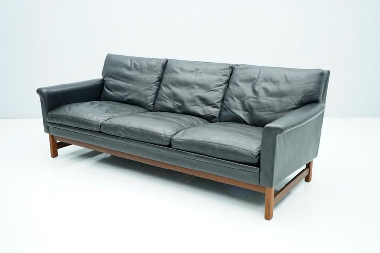 Scandinavian Modern Scandinavian Three-Seat Sofa in Teak Wood and Black Leather, 1960s For Sale