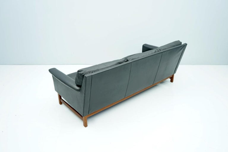Danish Scandinavian Three-Seat Sofa in Teak Wood and Black Leather, 1960s For Sale