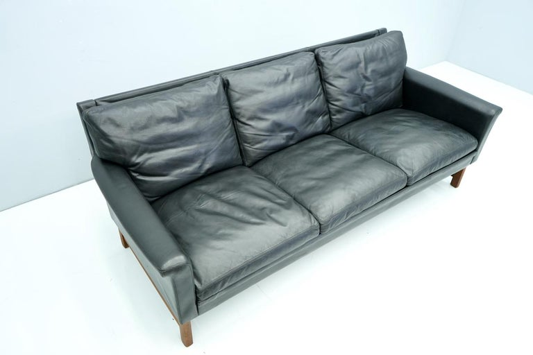 Scandinavian Three-Seat Sofa in Teak Wood and Black Leather, 1960s For Sale 1