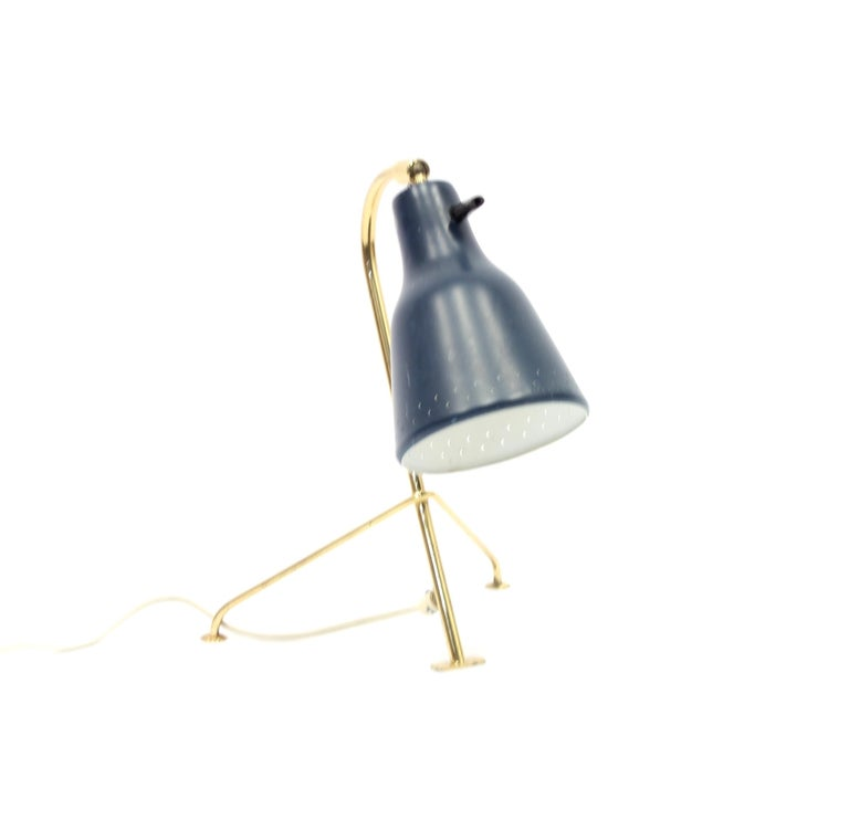 Scandinavian tripod brass table lamp with dark blue tin shade. Ware consistent with age and use.