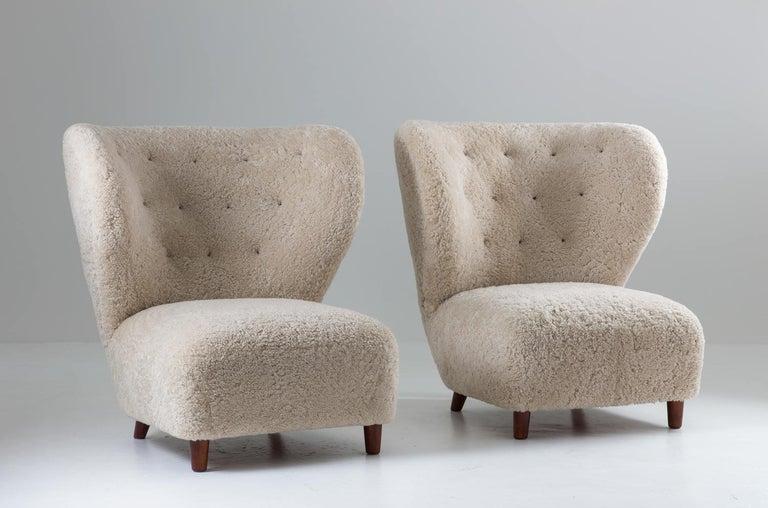 Scandinavian Modern Scandinavian Wingback Lounge Chairs in Sheepskin, 1930s For Sale