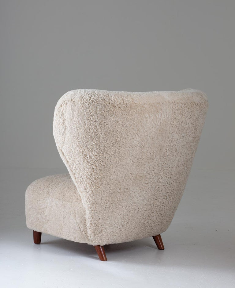 Scandinavian Wingback Lounge Chairs in Sheepskin, 1930s In Good Condition For Sale In Karlstad, SE