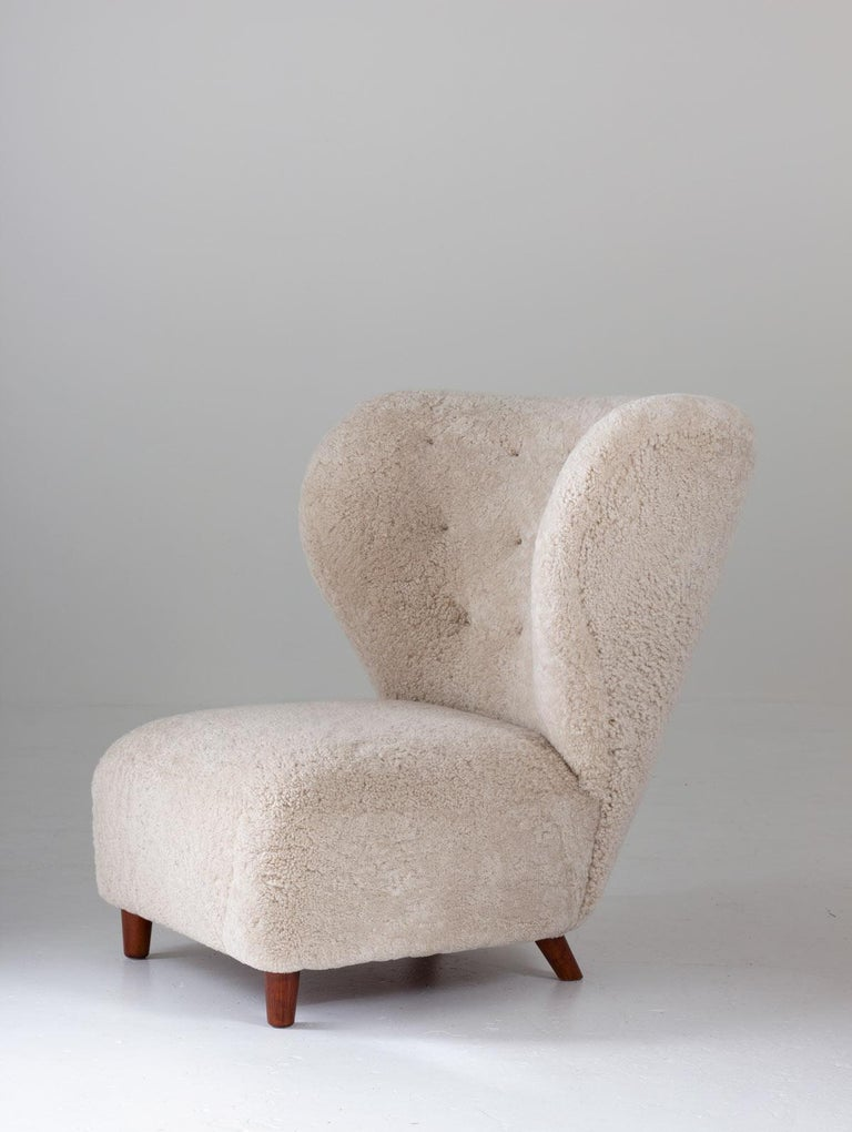 20th Century Scandinavian Wingback Lounge Chairs in Sheepskin, 1930s For Sale
