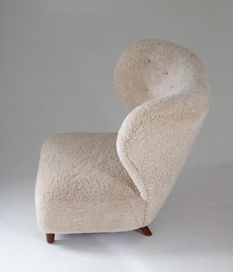 Scandinavian Wingback Lounge Chairs in Sheepskin, 1930s For Sale 1