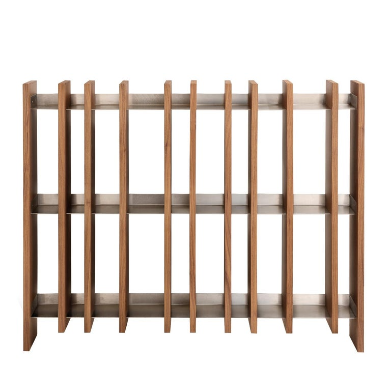 A unique piece of contemporary allure, this bookcase designed by Studiomartino5 is composed of 11 vertical panels made of Canaletto walnut-veneered plywood intersecting three horizontal shelves in stainless steel. This geometric and captivating