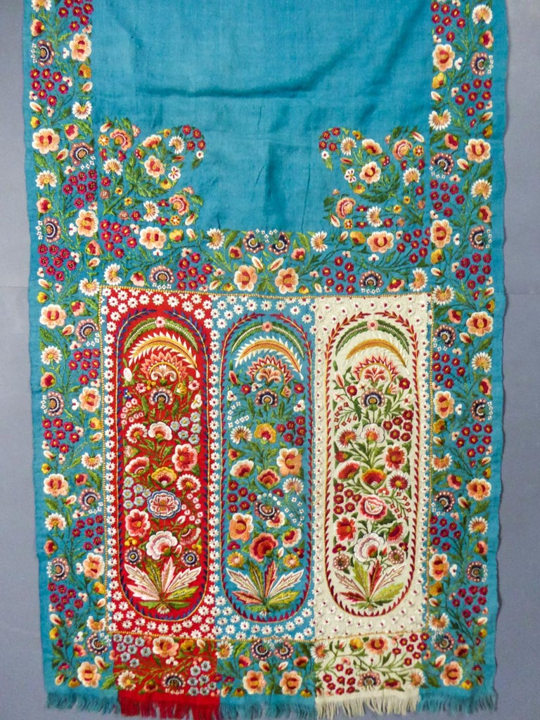 Circa 1830/1860 British India Company  Rich turquoise pashmina scarf densely embroidered with harlequin palms, Indian production from Delhi in the 19th century for fashion in England and Europe. Turquoise pashmina twill background with polychrome