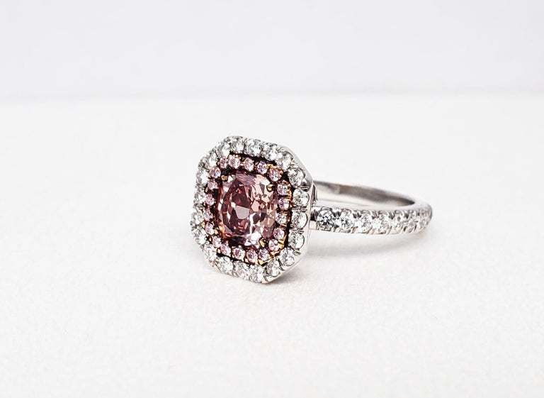 From SCARSELLI this Natural Fancy Deep Pink Radiant diamond of 1.02 carats, I1 clarity mounted in an 18k yellow gold with a halo of fancy pink round diamonds. The center diamond is accompanied by a GIA grading report #15696798. This diamond is