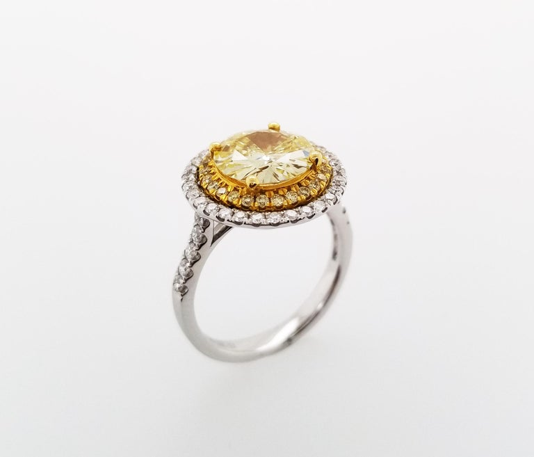 This Beautiful sunflower inspired design Ring From Scarselli features a 2-carat Fancy Yellow round brilliant Cut Diamond VS1 clarity with GIA certificate 15286878 (see certificate picture for more detailed stone's information)  The center diamond is