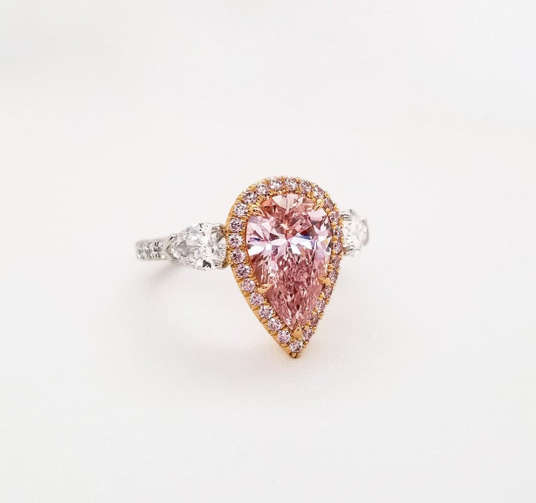From SCARSELLI, this 2.01-carat fancy pink pear shape Diamond GIA certified (see certificate picture for detailed stone's information). The center diamond enhanced by 0.23ct round brilliant pink is flanked by a pair of 0.79ct white pear shape