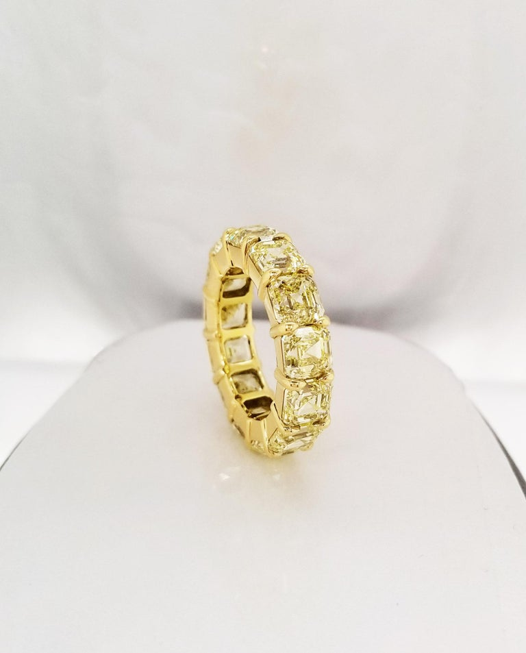 This fancy yellow Asscher Cut Eternity band is a pleasure to wear every day and contains 13.33 carats of natural fancy yellow diamonds of VVS - VS clarity in 18 karat yellow gold. Each diamond has a GIA grading certificate (13 stones certified).