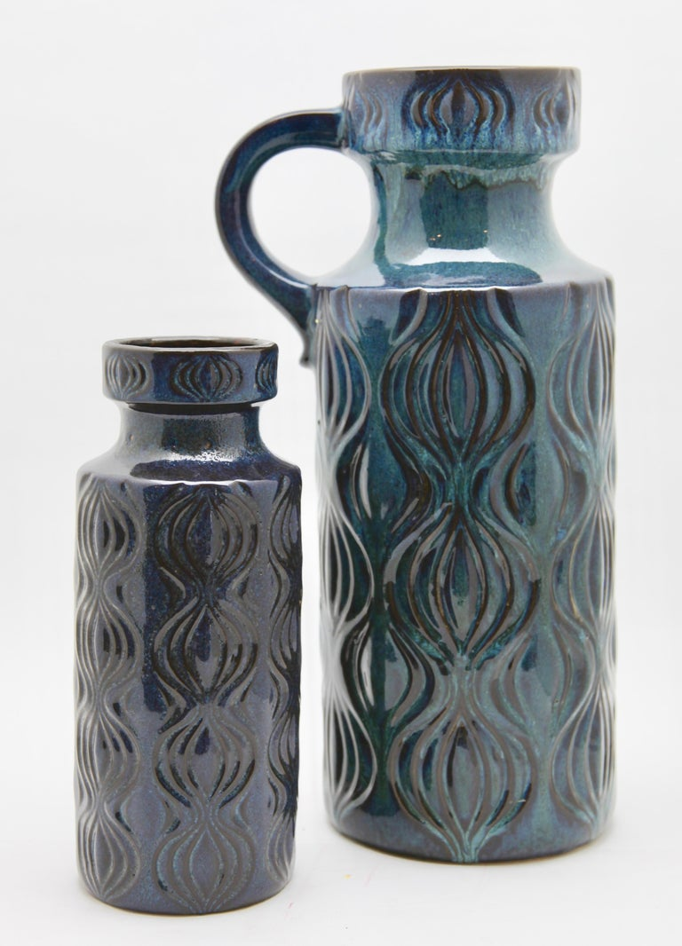 Two Scheurich vases in blue or black drip glaze featuring the indented pattern 'Amsterdam', (so named because the design was inspired by the map of Amsterdam's central canal system). On close inspection the glaze includes flecks of green turquoise