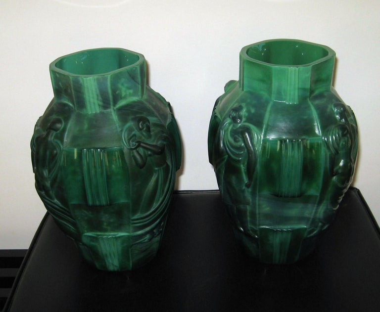 """Pair of identical green Czech Moser Malachite glass vases by Schlevogt. Called the """"Ingrid Vases."""" Created, circa 1930s. In very good, vintage condition- no chips, cracks or major scratches. Pattern depicts four women in various poses separated"""