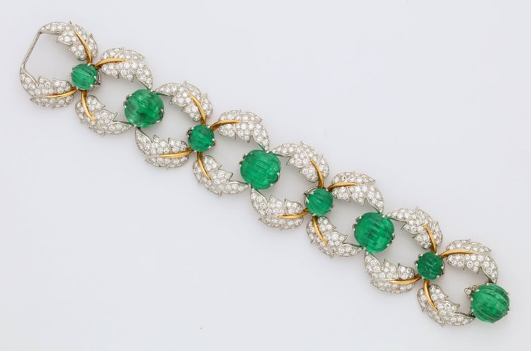 A unique and iconic set made by the legendary Jean Schlumberger for Tiffany and Co.  Set with a very rare layout of carved emeralds.  Consisting of a bracelet, earrings and necklace  Made in France circa 1950  A full page image of this set is