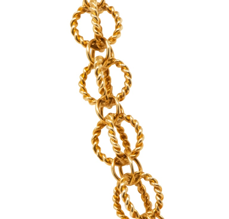 Link style necklace featuring large cage-like links comprised of a twisted rope motif  Interconnected with smaller cage-like polished gold links  Completed by concealed swinging hinged clasp with figure-eight safety  Fully signed Schlumberger and