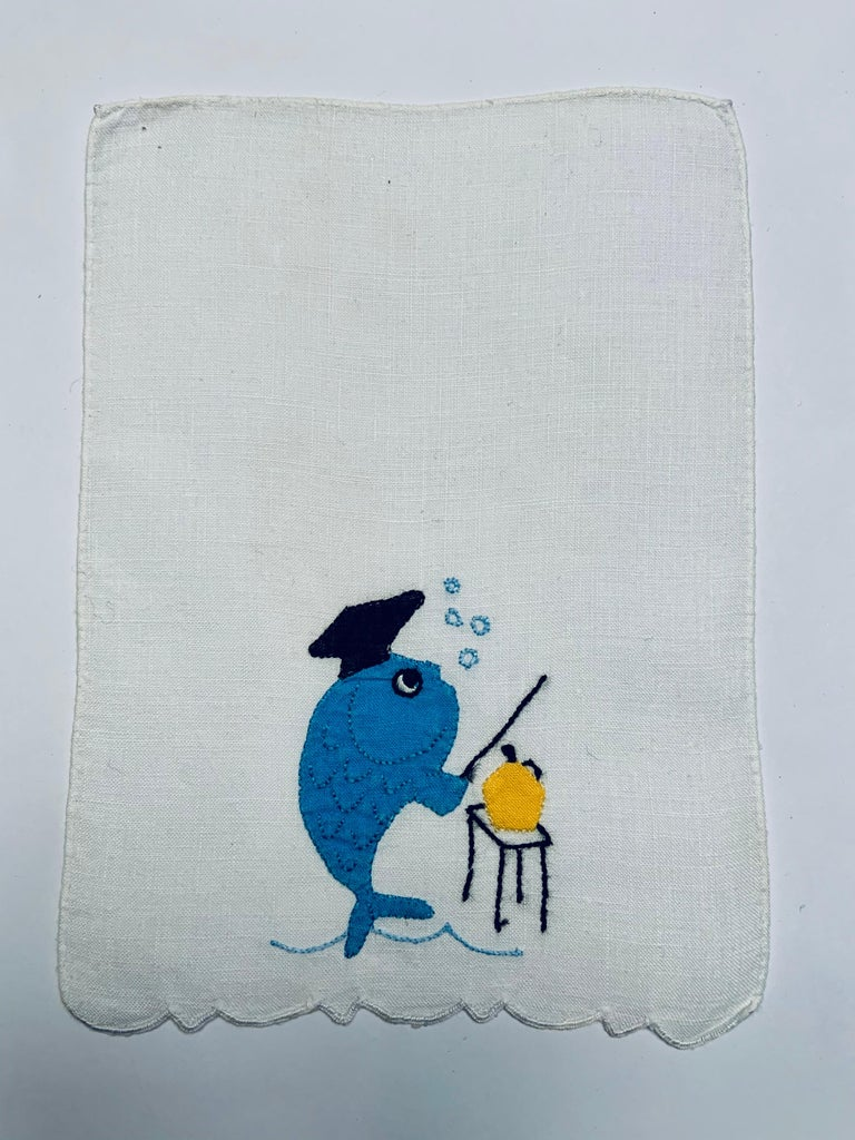 An appliqued and embroidered aqua blue