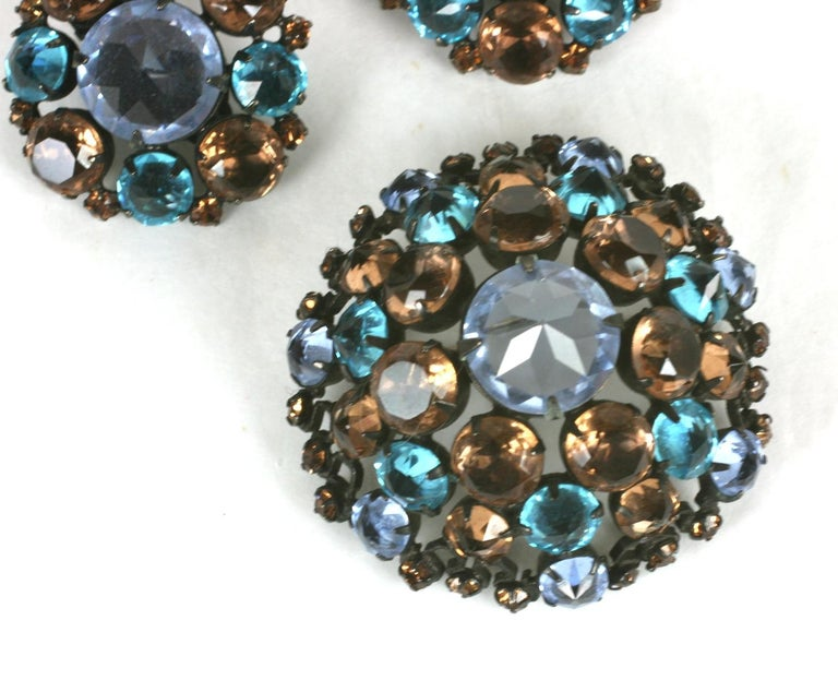 Lovely Schreiner Aquamarine and Topaz Set set in japanned metal from the 1950's. Dome form brooch with matching clip earrings. The blue glass stones are all set upside down (as Schreiner does)  and the sherry colored stones with points down.  1950's