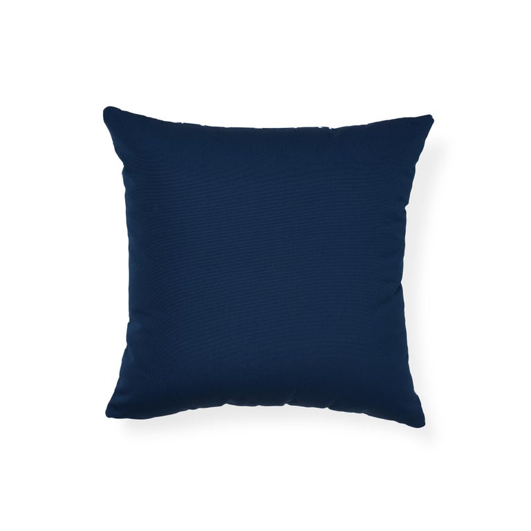 The face of this indoor or outdoor pillow features iconic leopard in navy paired with Ravello in indigo on the back. A sexy animal print first introduced in the 1970s, Iconic leopard is a perennial favorite. Indoor/outdoor synthetic pillow insert