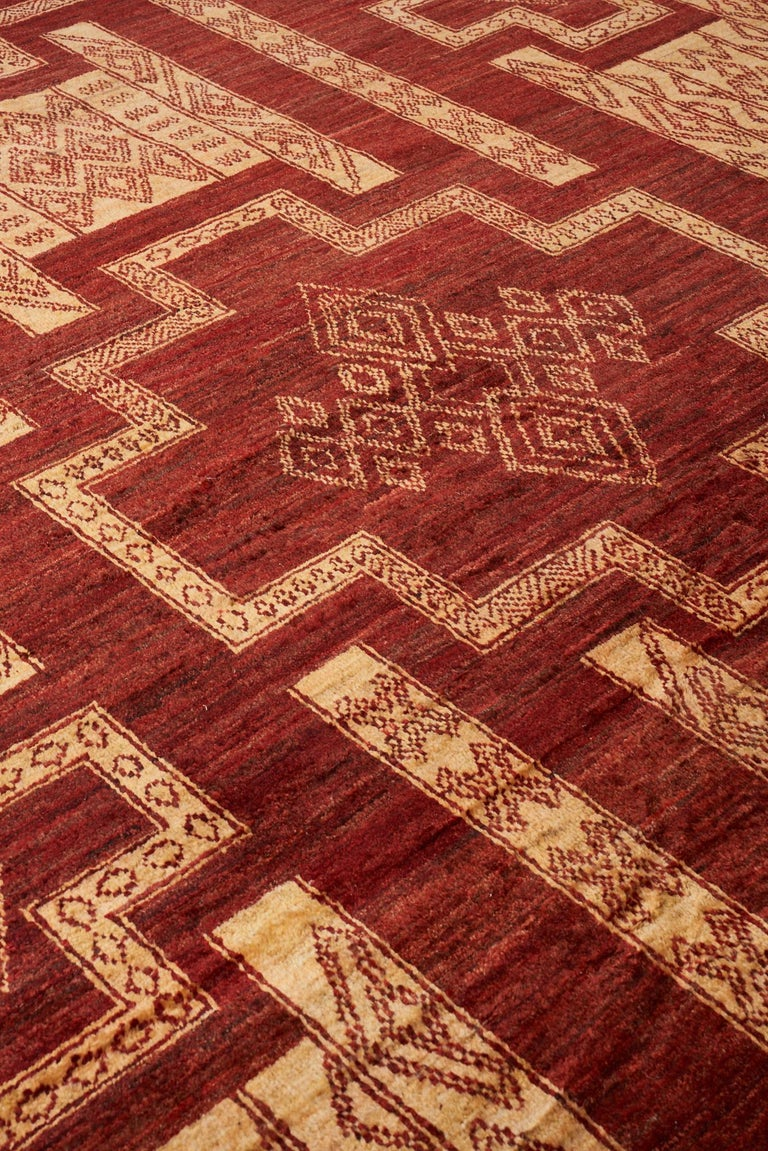Lose yourself in the rich colors and intricate designs of the Arua collection. Inspired by the most resilient desert dwellers of the Saharas, these hand-knotted rugs are made with wool from the highlands of Afghanistan. Traditional tribal symbols