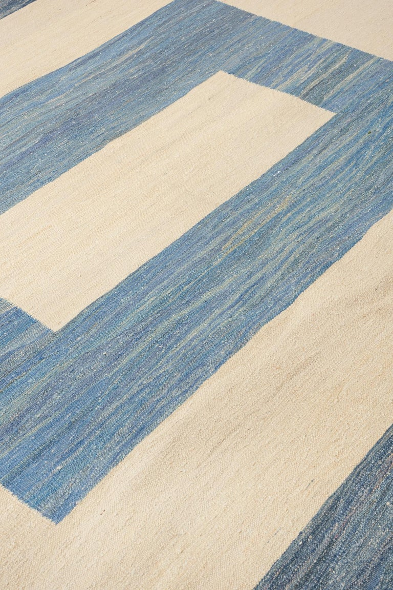 Rugs and floor coverings Rug pattern: Kilim Dimensions: 10' x 14' Fiber content: Wool Construction: Handwoven Colorway: Blue  Handmade rugs are subject to size variations of up to 3%. Due to variations in dye lots, actual colors are not