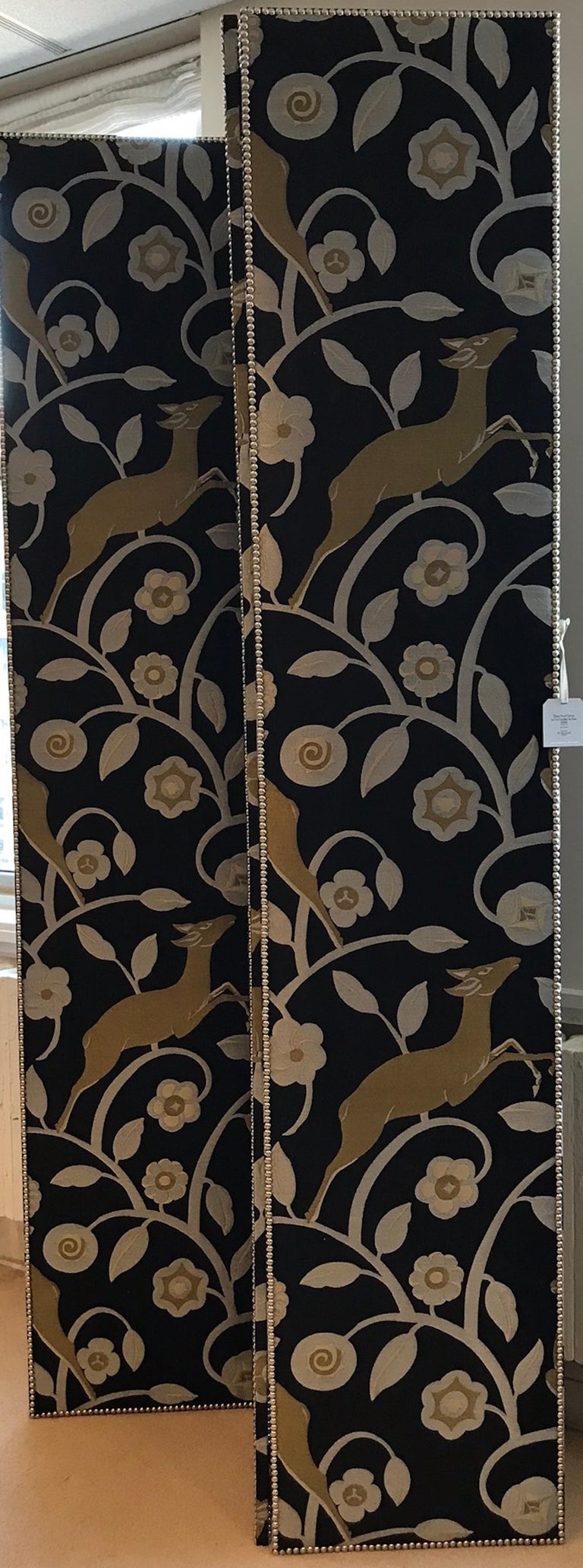 This three panel screen includes a floral and animal design that is colored in gold hues on a black backdrop. The nailhead detailing creates a clean boarder to this elegant accessory and room divider!   Since Schumacher was founded in 1889, our