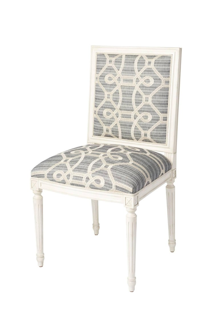 The Marie Thereseside chair is a classic, timeless silhouette that features a hand-carved European beechwood frame. This chair is upholstered in Schumacher Ziz Embroidery. With an intentionally irregular strié ground and a fanciful updated trellis