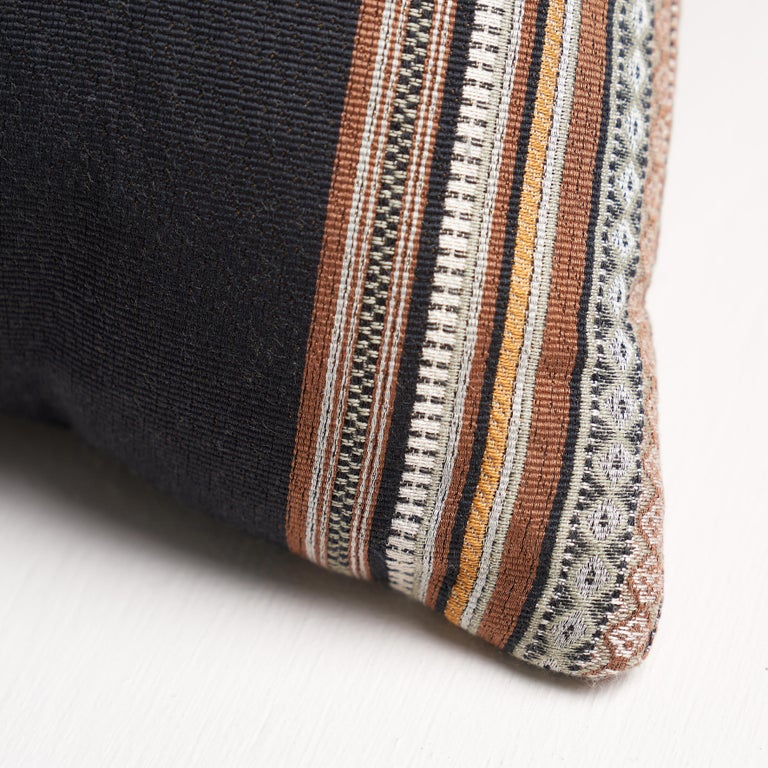 This pillow features Markova Stripe with a knife edge finish. This elaborately detailed, multi-color showstopper is the perfect upholstery weight stripe. It's a wonderfully pattern in an easy-to-use scale that will add a note of drama to any room.