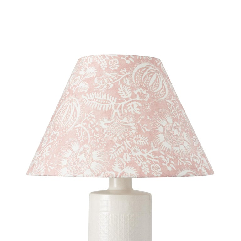 This lampshade features our Pomegranate Print in Petal. This lively pomegranate pattern was inspired by an antique resist print. It's a classic, versatile botanical design with wonderful color variations and textural nuance. Measures: 8