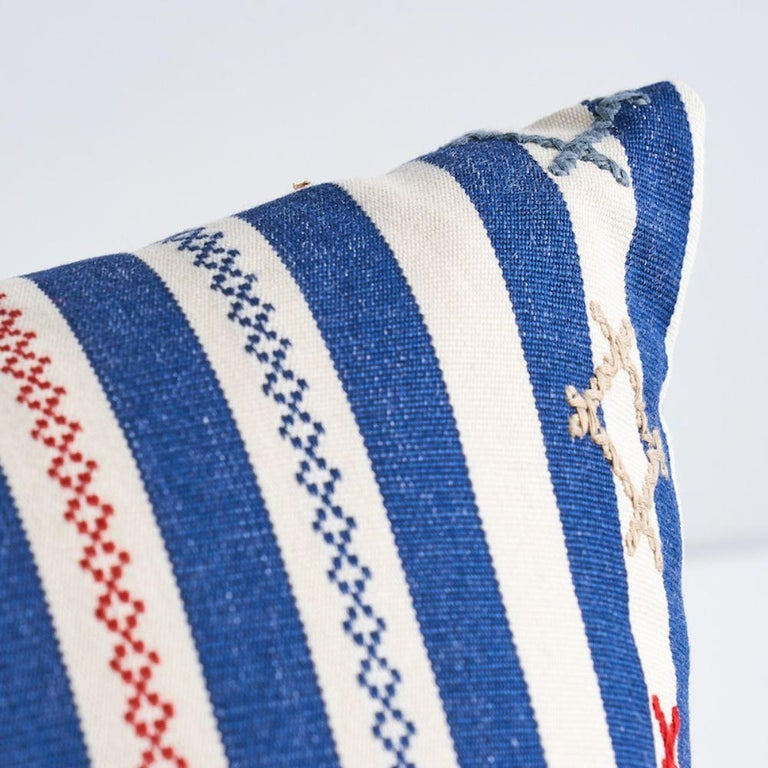 This pillow features Rhodes Stripe with aknife edge finish. Inspired by Ukrainian needlework, Rhodes Stripe is a woven stripe overlaid with charming cross-stitched flourishes that take it from ordinary to extraordinary. Pillow includes a